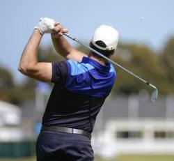 golfer swing a golf club