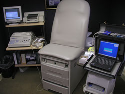 The area in which a patient would get a nerve test with equipment around a patient chair
